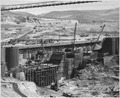 """""""View of the west side of block 40 showing construction of timber crib tie-in structure across bucket section... - NARA - 294282.tif"""