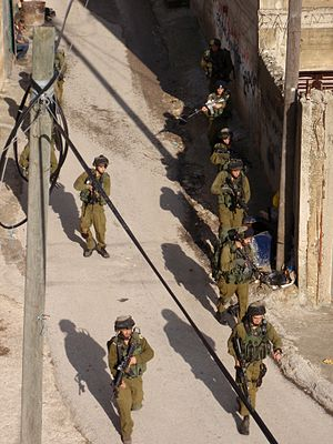 Awarta - Israeli soldiers patrolling Awarta on the day after the Itamar attack