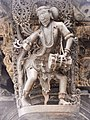 12th-century sculpture at Belur Hindu temple, a musician with a drum sculpture.jpg