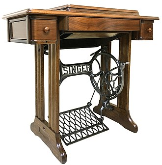 Treadle - A table fitted with a sewing treadle