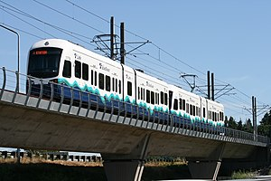 Central Link - A two-car light rail train on an elevated guideway in Tukwila