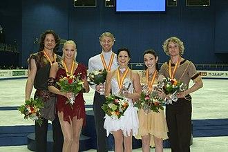 2008–09 Grand Prix of Figure Skating Final - The ice dancing podium. From left: Oksana Domnina / Maxim Shabalin (2nd), Isabelle Delobel / Olivier Schoenfelder (1st), Meryl Davis / Charlie White (3rd).