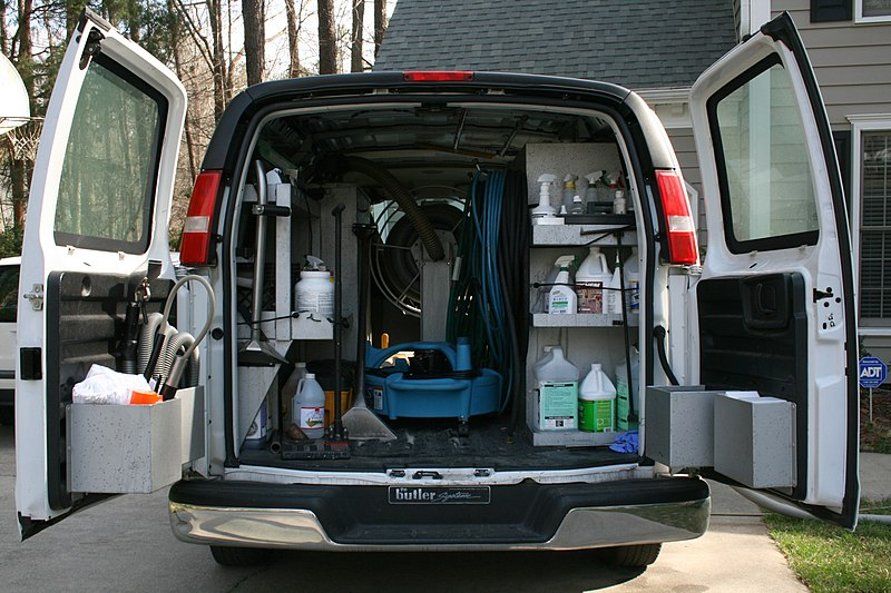 professional carpet cleaning vehicle loaded with carpet cleaning chemicals and equipment