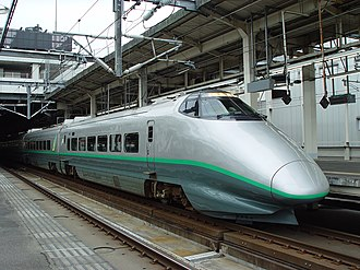 400 Series Shinkansen - Set L1 at Omiya Station in June 2002, showing the door steps extended