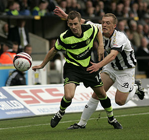 Niall McGinn - McGinn clashing with a St Mirren player with the ball.