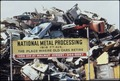 AUTO JUNKYARD, WHERE CARS ARE SHREDDED AND COMPACTED - NARA - 544819.tif
