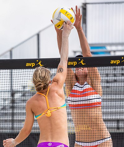 "Open-handed tips/dinks are not allowed. Players may instead use their knuckles to attack the ball for a ""pokey"" shot. AVP Professional Beach Volleyball in Austin, Texas (2017-05-19) (34629625214).jpg"