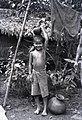 A Child with a Water Jug on his Head (BOND 0033).jpeg