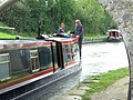 A Narrowboat passing under Bridge 131 on the Grand Union Canal - geograph.org.uk - 1468251.jpg