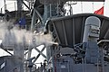 A Phalanx close-in weapons system is fired during a test of shipboard defense systems aboard the amphibious assault ship USS Bonhomme Richard (LHD 6) May 13, 2013, in the East China Sea 130513-N-BJ178-157.jpg