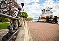 A Simpler Time Statue and Riverside Park levee.jpg