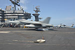 A U.S. Navy F-A-18C Hornet aircraft attached to Marine Fighter Attack Squadron (VMFA) 312 lands on the flight deck of the aircraft carrier USS Harry S. Truman (CVN 75) in the Gulf of Oman March 10, 2014 140310-N-CC806-092.jpg