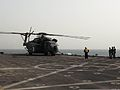 A U.S. Navy MH-53E Sea Dragon helicopter attached to Helicopter Mine Countermeasures Squadron (HM) 15 prepares to take off from the afloat forward staging base USS Ponce (AFSB(I) 15) during International Mine 130514-N-UT397-016.jpg