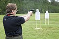 A business leader attending a Marine Corps Executive Forum (MCEF) fires an M9 Beretta pistol at a target aboard Marine Corps Base Quantico, Va., July 11, 2013 130711-M-MI461-349.jpg