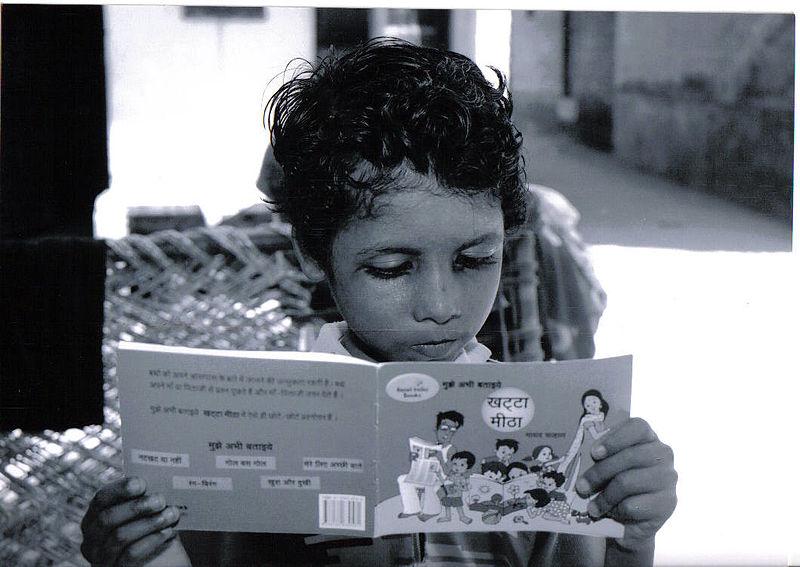 File:A child reading a book by Pratham Books - Flickr - Pratham Books (2).jpg