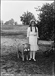 A young girl and her lamb (4903286435).jpg