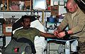 Afghan policeman helped by SFAT, FST 121213-A-BF245-362.jpg