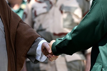 Ali Khamenei has shaken hands with his left hand since the unsuccessful assassination Ali Khamenei is shaking hand with his left hand.jpg
