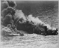 Allied tanker torpedoed in Atlantic Ocean by German submarine. Ship crumbling amidship under heat of fire, settles... - NARA - 520607.tif