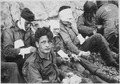 American assault troops of the 16th Infantry Regiment, injured while storming Omaha Beach, wait by the Chalk Cliffs... - NARA - 531187.tif
