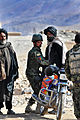 An Afghan National Army (ANA) soldier searches a man before allowing him to pass through a barricaded street near the Afghan Uniformed Police (AUP) District Headquarters in Chora district, Uruzgan province 130222-A-FS372-634.jpg