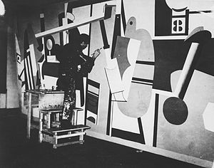 Arshile Gorky - Arshile Gorky working on Activities on the field, one of the panels for his mural Aviation at Newark Airport, for the Federal Art Project, 1936