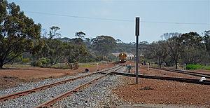 Ardath, Western Australia - A grain train enters Ardath station limits, 2013.