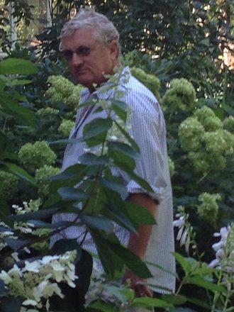Walter Robinson (artist) - Walter Robinson amidst green foliage, New York State, 2012