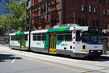 A B2 class tram in Bourke Street with a Waterfront City-bound service.