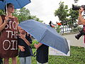 BP Oil Flood Protest Stop The Oil Oiled Pelican Umbrellas.JPG