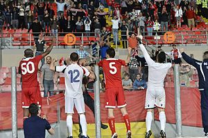 Balzan F.C. - Balzan F.C. players and supporters celebrate their Club's historic qualification to the UEFA Europa League following a 3 -1 victory over until then unbeaten 14/15 champions Hibernians F.C. on 26 April 2015.