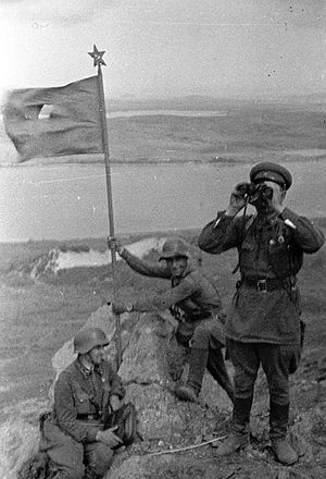 Battle of Lake Khasan - Image: Battle of Lake Khasan Red Army soldiers setting the flag on the Zaozernaya Hill