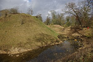 Berkhamsted - A view of the castle motte, moat, middle bank and outer earthworks.