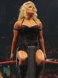 Beth Phoenix performing her signature ring entrance.