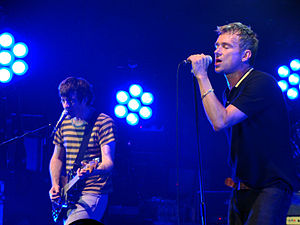 Blur (band) - Coxon (left) and Albarn on stage at the Newcastle Academy in June 2009.