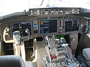 A cockpit of the 767-300F belonging to FedEx Express, which exhibits the complete removal of analog gauges and larger screens
