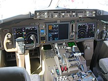 A cockpit of the 767-300F belonging to FedEx Express, which exhibits the complete removal of anolog gauges and larger screens.