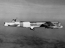 Black-and-white photo of a B-52 inflight with its vertical stabilizer sheared off.