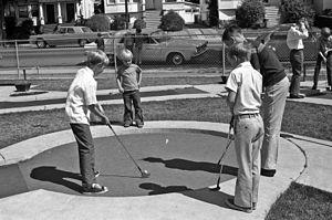 Miniature golf - Boys playing miniature golf in Alameda County, California, 1963