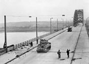 British XXX Corps cross the road bridge at Nijmegen