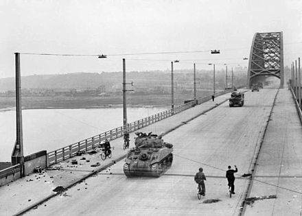 British tanks of XXX Corps cross the road bridge at Nijmegen. British XXX Corps cross the road bridge at Nijmegen.jpg