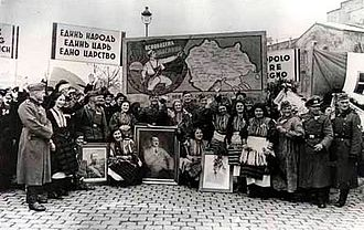 World War II in Yugoslav Macedonia - Macedonians in Sofia posing with German soldiers after the invasion in Yugoslavia. The posters praise the unification with Bulgaria, and United Macedonia. When German troops advanced into Yugoslav Macedonia, the crowds in Skopje, displayed the same banners.
