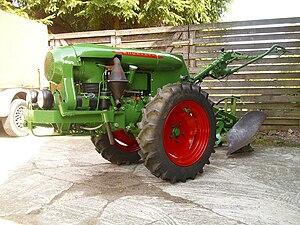 Two-wheel tractor - A 1952 Bungartz model U1D walk-behind, showing a moldboard plow attached.