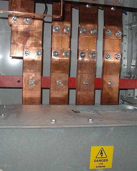 Copper electrical busbars distributing power to a large building Busbars.jpg