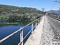 CAT700 2019 travessant l'Ebre pel pont del ferrocarril a Garcia.jpg