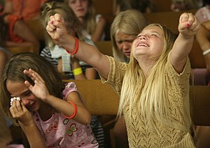 Evangelicalism - Children worshipping at the Harvestime Church of Eau Claire, Wisconsin