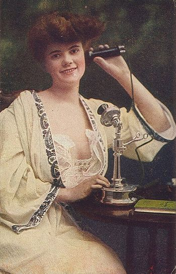 An early 20th century candlestick phone being ...
