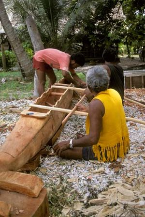 Ama (sailing) - Men carve a canoe on Nanumea Atoll in Tuvalu.