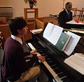 Capitola Dickerson memorial 10 piano student Sam Sulcer at piano and singer Bill Robinson.jpg