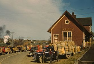 Caribou, Maine - Trucks outside a starch factory in October, 1940
